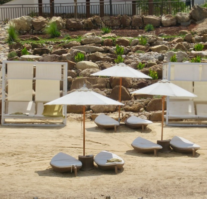 boat shaped beach chairs at the dead sea hilton