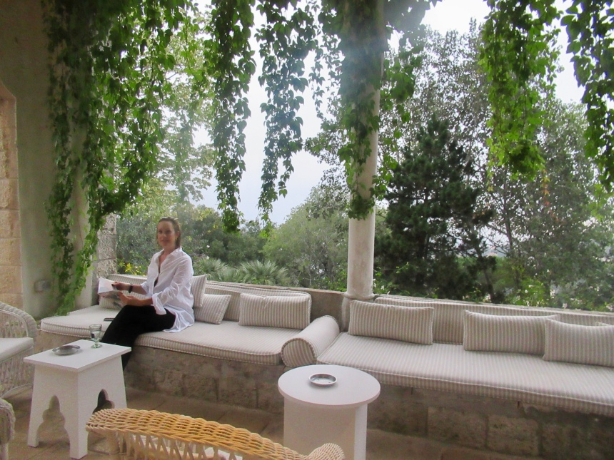 catching up on hello magazine in an outdoor oasis at beit trad