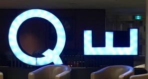 the lobby's neon QE