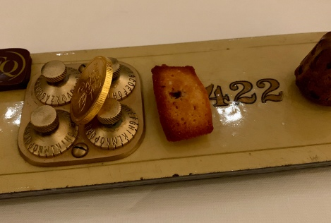 dessert served on old safety deposit box doors