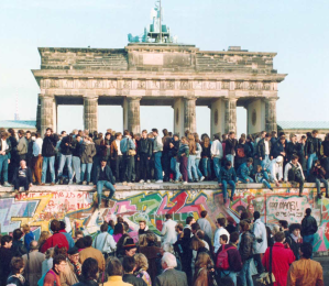 celebrating ate the brandenburg gate in 1989